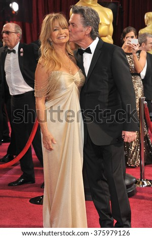 LOS ANGELES, CA - MARCH 2, 2014: Goldie Hawn & Kurt Russell at the 86th Annual Academy Awards at the Dolby Theatre, Hollywood.