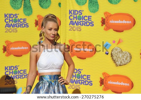 LOS ANGELES, CA - MARCH 28, 2015: Iggy Azalea at the 2015 Kids Choice Awards at The Forum, Los Angeles.  - stock photo