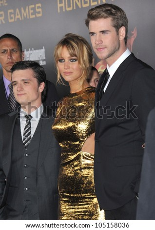 """LOS ANGELES, CA - MARCH 12, 2012: Jennifer Lawrence, Josh Hutcherson (left) & Liam Hemsworth at the world premiere of """"The Hunger Games"""" at the Nokia Theatre L.A. Live March 12, 2012  Los Angeles, CA - stock photo"""