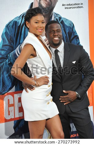"LOS ANGELES, CA - MARCH 25, 2015: Kevin Hart & guest at the Los Angeles premiere of his movie ""Get Hard"" at the TCL Chinese Theatre, Hollywood.  - stock photo"