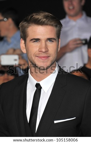 "LOS ANGELES, CA - MARCH 12, 2012: Liam Hemsworth at the world premiere of his new movie ""The Hunger Games"" at the Nokia Theatre L.A. Live. March 12, 2012  Los Angeles, CA - stock photo"