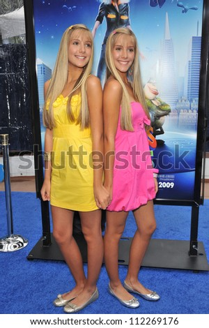 """LOS ANGELES, CA - MARCH 22, 2009: Milly Rosso & Becky Rosso at the Los Angeles premiere of """"Monsters vs. Aliens"""" at the Gibson Amphitheatre, Universal Studios - stock photo"""