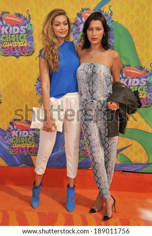 LOS ANGELES, CA - MARCH 29, 2014: Model Gigi Hadid (left) & sister Bella at Nickelodeon's 27th Annual Kids' Choice Awards at the Galen Centre, Los Angeles.  - stock photo