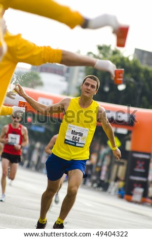 LOS ANGELES, CA - MARCH 22: Runner at 2010 LA marathon on March 22, 2010 in Los Angeles, California. - stock photo