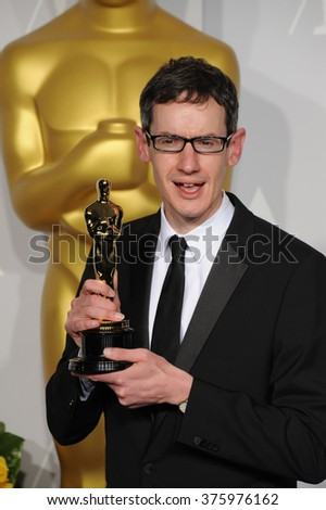LOS ANGELES, CA - MARCH 2, 2014: Steven Price at the 86th Annual Academy Awards at the Dolby Theatre, Hollywood.