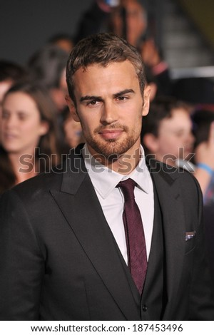 "LOS ANGELES, CA - MARCH 18, 2014: Theo James at the Los Angeles premiere of his movie ""Divergent"" at the Regency Bruin Theatre, Westwood.  - stock photo"