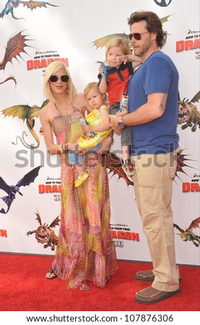 "LOS ANGELES, CA - MARCH 21, 2010: Tori Spelling & family at the Los Angeles premiere of Dreamworks Animation's ""How To Train Your Dragon"" at Gibson Amphitheatre, Universal Studios, Hollywood. - stock photo"