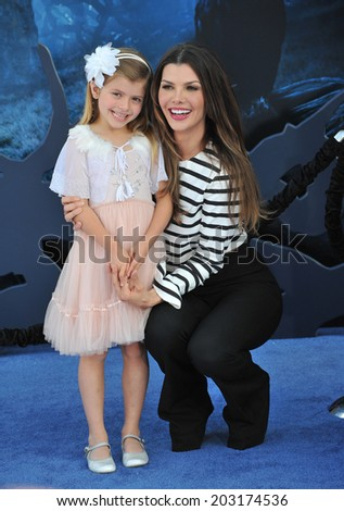 """LOS ANGELES, CA - MAY 29, 2014: Ali Landry & daughter at the world premiere of """"Maleficent"""" at the El Capitan Theatre, Hollywood.  - stock photo"""