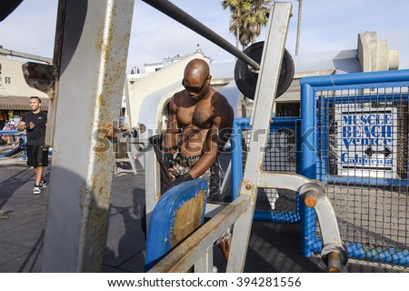 LOS ANGELES, CA - MAY 30: An unidentified bodybuilder at Muscle Beach gym on Venice Beach, CA on MAY 30, 2015.  Muscle Beach is an  outdoor gym dating back to the 1930's where famous athletes trained.