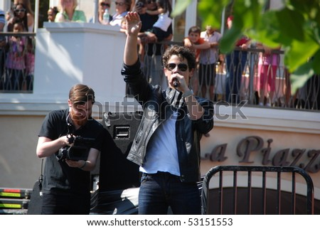 LOS ANGELES, CA- MAY 15: Nick Jonas performs at The Jonas Brothers summer tour kickoff at The Grove on May 15, 2010 in Los Angeles, California. - stock photo