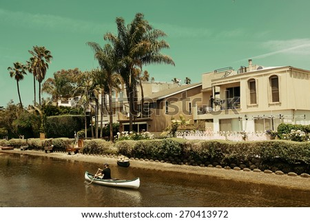 Los Angeles, CA - MAY 18: Venice Canals Walkway with boat on mountain on May 18, 2014 in Los Angeles. Los Angeles is the second-most populous city after New York in USA. - stock photo