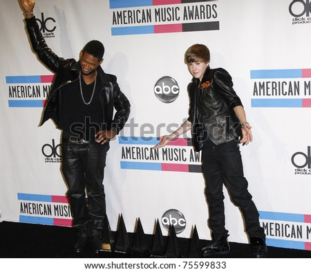 LOS ANGELES, CA - NOV 21:  Usher and Justin Bieber at the 2010 American Music Awards held at the Nokia Theater on November 21, 2010 in Los Angeles, California. - stock photo