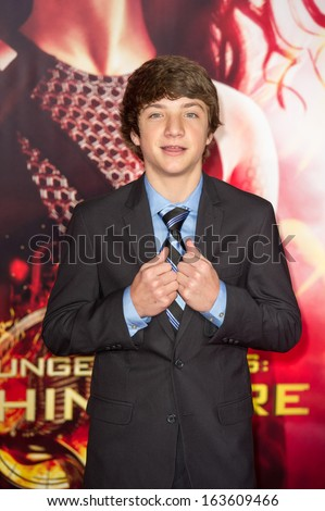 LOS ANGELES, CA - NOVEMBER 18: Actor Jake Short arrives at the premiere of The Hunger Games: Catching Fire at the Nokia Theater in Los Angeles, CA on November 18, 2013