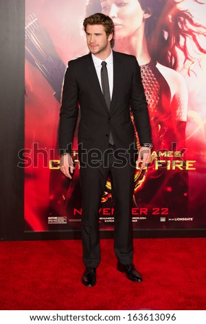 LOS ANGELES, CA - NOVEMBER 18: Actor Liam Hemsworth arrives at the premiere of The Hunger Games: Catching Fire at the Nokia Theater in Los Angeles, CA on November 18, 2013 - stock photo