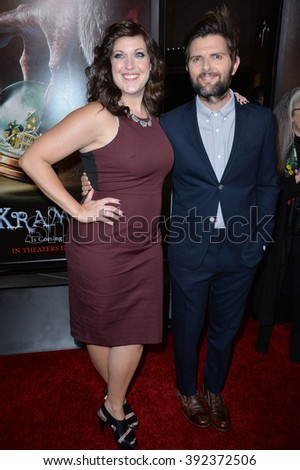 "LOS ANGELES, CA - NOVEMBER 30, 2015: Actors Adam Scott & Allison Tolman at the Los Angeles premiere of their movie ""Krampus"" at the Arclight Theatre, Hollywood"