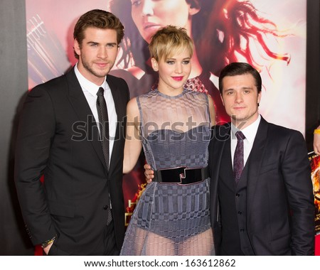LOS ANGELES, CA - NOVEMBER 18: Actors Liam Hemsworth, Jennifer Lawrence and Josh Hutcherson attend the premiere of The Hunger Games: Catching Fire in Los Angeles, CA on November 18, 2013 - stock photo