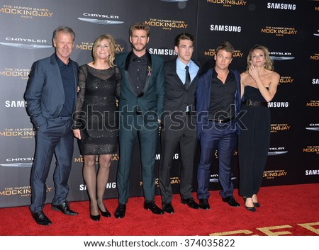 "LOS ANGELES, CA - NOVEMBER 16, 2015: Actors Liam Hemsworth (3rd from left), Luke Hemsworth (2nd from right) & parents & family at the premiere of ""The Hunger Games: Mockingjay - Part 2"".   - stock photo"