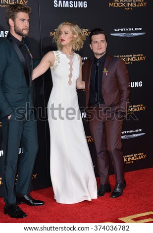 "LOS ANGELES, CA - NOVEMBER 16, 2015: Actress Jennifer Lawrence & actors Liam Hemsworth & Josh Hutcherson (right) at the premiere of ""The Hunger Games: Mockingjay - Part 2""."
