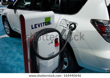 LOS ANGELES, CA - NOVEMBER 20: An electric vehicle recharging station on exhibit at the Los Angeles Auto Show in Los Angeles, CA on November 20, 2013