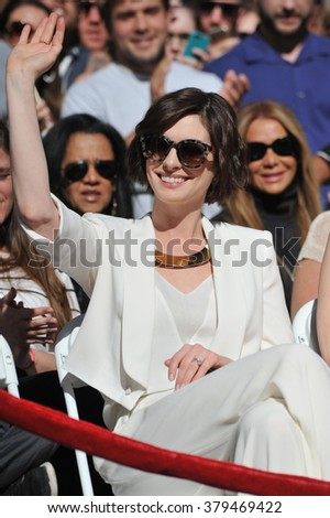 LOS ANGELES, CA - NOVEMBER 17, 2014: Anne Hathaway on Hollywood Boulevard where Matthew McConaughey was honored with the 2,534th star on the Hollywood Walk of Fame. - stock photo