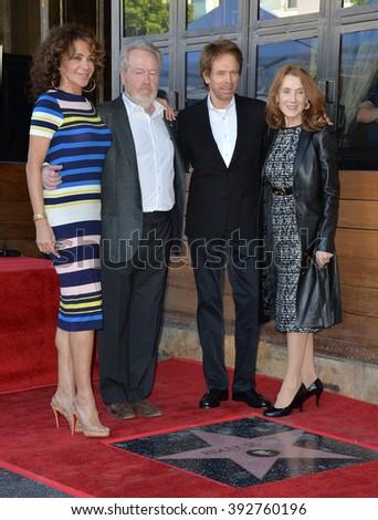 LOS ANGELES, CA - NOVEMBER 5, 2015: Director Ridley Scott & partner Giannina Facio with producer Jerry Bruckheimer & wife Linda at Scott's Walk of Fame star ceremony - stock photo