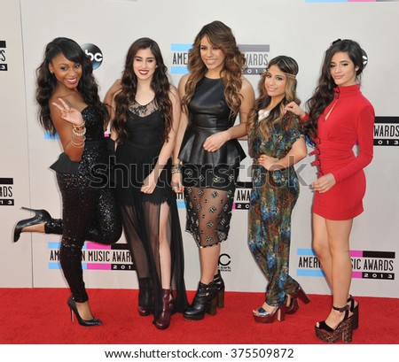 LOS ANGELES, CA - NOVEMBER 24, 2013: Fifth Harmony at the 2013 American Music Awards at the Nokia Theatre, LA Live.  - stock photo