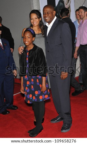 "LOS ANGELES, CA - NOVEMBER 9, 2009: Forest Whitaker, wife Keisha Whitaker & daughter Sonnet Whitaker at the world premiere of Walt Disney's ""Old Dogs"" at the El Capitan Theatre, Hollywood. - stock photo"