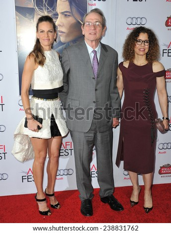 """LOS ANGELES, CA - NOVEMBER 11, 2014: Hilary Swank (left) with Tommy Lee Jones & wife Dawn Laurel-Jones at the gala screening of """"The Homesman"""" as part of the AFI Fest 2014 at the Dolby Theatre.  - stock photo"""