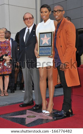 LOS ANGELES, CA - NOVEMBER 13, 2013: Jennifer Hudson with Clive Davis (left) & musician Raphael Saadiq on Hollywood Blvd where she was honored with the 2,512th star on the Hollywood Walk of Fame.  - stock photo