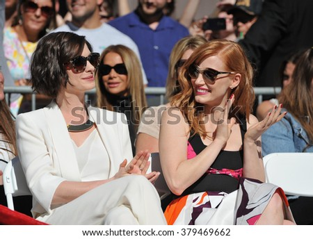 LOS ANGELES, CA - NOVEMBER 17, 2014: Jessica Chastain & Anne Hathaway (left) on Hollywood Boulevard where Matthew McConaughey was honored with the 2,534th star on the Hollywood Walk of Fame. - stock photo