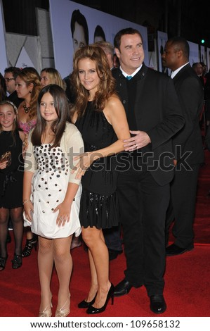 "LOS ANGELES, CA - NOVEMBER 9, 2009: John Travolta & wife Kelly Preston & daughter Ella Beu Travolta at the world premiere of their movie Walt Disney's ""Old Dogs"" at the El Capitan Theatre, Hollywood. - stock photo"