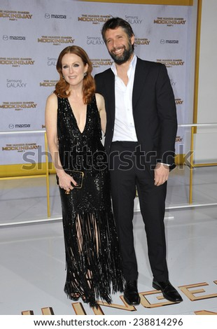 """LOS ANGELES, CA - NOVEMBER 17, 2014: Julianne Moore & husband Bart Freundlich at the Los Angeles premiere of her movie """"The Hunger Games: Mockingjay Part One"""" at the Nokia Theatre LA Live.  - stock photo"""