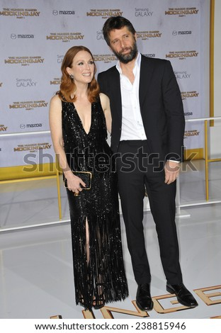 "LOS ANGELES, CA - NOVEMBER 17, 2014: Julianne Moore & husband Bart Freundlich at the Los Angeles premiere of her movie ""The Hunger Games: Mockingjay Part One"" at the Nokia Theatre LA Live.  - stock photo"