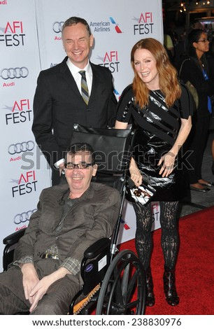 """LOS ANGELES, CA - NOVEMBER 12, 2014: Julianne Moore with directors Wash Westmoreland & Richard Glatzer (front) at the premiere of """"Still Alice"""" as part of the AFI FEST 2014 at the Dolby Theatre.   - stock photo"""