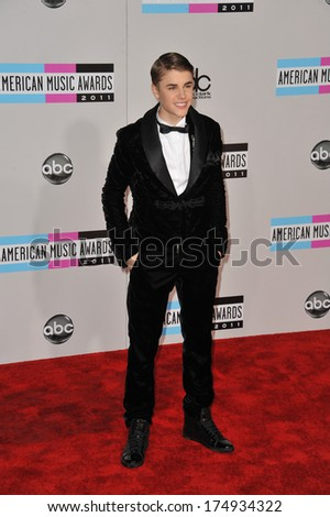 LOS ANGELES, CA - NOVEMBER 20, 2011: Justin Bieber arriving at the 2011 American Music Awards at the Nokia Theatre, L.A. Live in downtown Los Angeles.  - stock photo