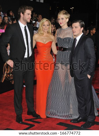 """LOS ANGELES, CA - NOVEMBER 18, 2013: LtoR: Liam Hemsworth, Elizabeth Banks, Jennifer Lawrence & Josh Hutcherson at the US premiere of """"The Hunger Games: Catching Fire"""" at the Nokia Theatre LA Live.  - stock photo"""