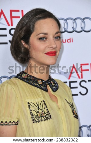 "LOS ANGELES, CA - NOVEMBER 7, 2014: Marion Cotillard at the AFI Fest screening of her movie ""Two Days, One Night"" at the Egyptian Theatre, Hollywood.  - stock photo"