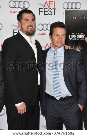 """LOS ANGELES, CA - NOVEMBER 12, 2013: Mark Wahlberg (right) with retired Petty Officer 1st Class Marcus Luttrell at the world premiere of his movie """"Lone Survivor"""" at the TCL Chinese Theatre, Hollywood - stock photo"""