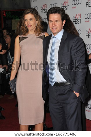 """LOS ANGELES, CA - NOVEMBER 12, 2013: Mark Wahlberg & wife Rhea Durham at the world premiere of his movie """"Lone Survivor"""", part of the AFI Fest 2013, at the TCL Chinese Theatre, Hollywood.  - stock photo"""