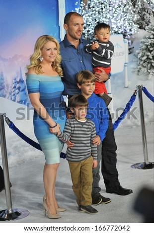 """LOS ANGELES, CA - NOVEMBER 19, 2013: Melissa Joan Hart & husband Mark Wilkerson & children at the premiere of Disney's """"Frozen"""" at the El Capitan Theatre, Hollywood.  - stock photo"""