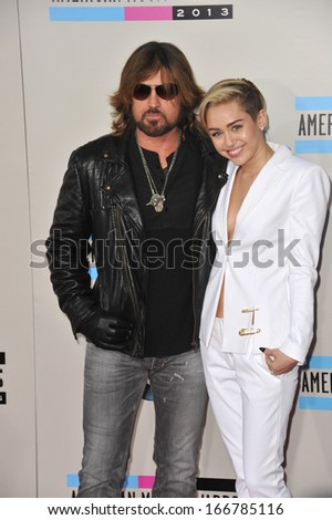 LOS ANGELES, CA - NOVEMBER 24, 2013: Miley Cyrus & father Billy Ray Cyrus at the 2013 American Music Awards at the Nokia Theatre, LA Live.  - stock photo