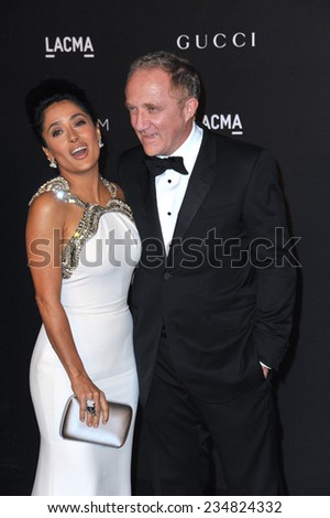 LOS ANGELES, CA - NOVEMBER 1, 2014: Salma Hayek & husband Francois-Henri Pinault at the 2014 LACMA Art+Film Gala at the Los Angeles County Museum of Art.  - stock photo