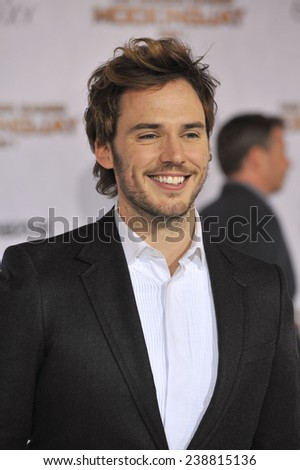 """LOS ANGELES, CA - NOVEMBER 17, 2014: Sam Claflin at the Los Angeles premiere of his movie """"The Hunger Games: Mockingjay Part One"""" at the Nokia Theatre LA Live.  - stock photo"""