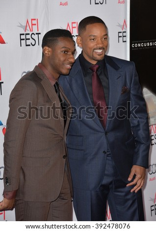 """LOS ANGELES, CA - NOVEMBER 10, 2015: Singer/songwriter Leon Bridges (left) & actor Will Smith at the premiere of """"Concussion"""" at the TCL Chinese Theatre - stock photo"""
