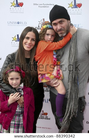 LOS ANGELES, CA - NOVEMBER 06: Soleil Moon Frye and family arrive at A Day Of Champions Benefiting the Bogart Pediatric Cancer Research Program at Sports Museum of Los Angeles on November 6, 2011. - stock photo