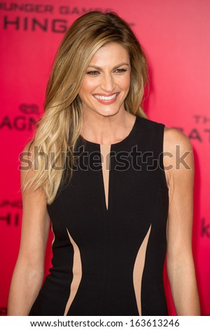LOS ANGELES, CA - NOVEMBER 18: Sportscaster Erin Andrews arrives at the premiere of The Hunger Games: Catching Fire at the Nokia Theater in Los Angeles, CA on November 18, 2013 - stock photo