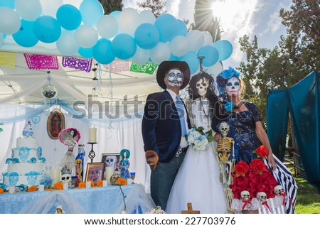 Los Angeles, CA - November 1, 2014:  Unknown people and altar on display at the 15th annual Day of the Dead Festival (Dia de los Muertos) at the Hollywood Forever Cemetary in Los Angeles, CA. - stock photo
