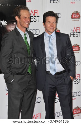 """LOS ANGELES, CA - NOVEMBER 12, 2013: Writer/director Peter Berg (left) & Mark Wahlberg at the world premiere of their movie """"Lone Survivor"""" at the TCL Chinese Theatre, Hollywood. - stock photo"""