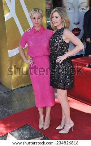 LOS ANGELES, CA - OCTOBER 29, 2014: Actress Kaley Cuoco & Ashley Jones (right) on Hollywood Boulevard where she was honored with the 2,532nd star on the Hollywood Walk of Fame.  - stock photo