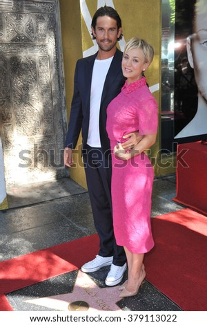 LOS ANGELES, CA - OCTOBER 29, 2014: Actress Kaley Cuoco & husband Ryan Sweeting on Hollywood Boulevard where she was honored with the 2,532nd star on the Hollywood Walk of Fame. - stock photo